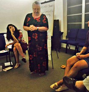 Maiya Zwerling (FCNL) listens as Clara Diaz practices her 'elevator speech.' photo: Brian Olson
